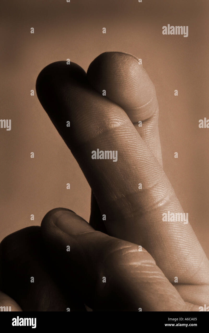 fingers crossed - Stock Image