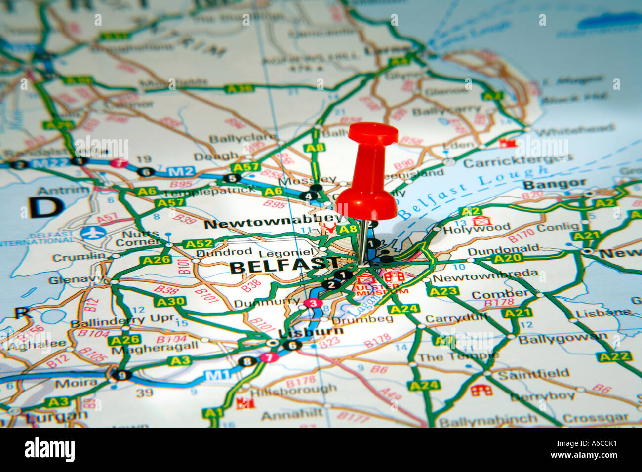 Map Pin pointing to Belfast , Northern Ireland on a road map Stock