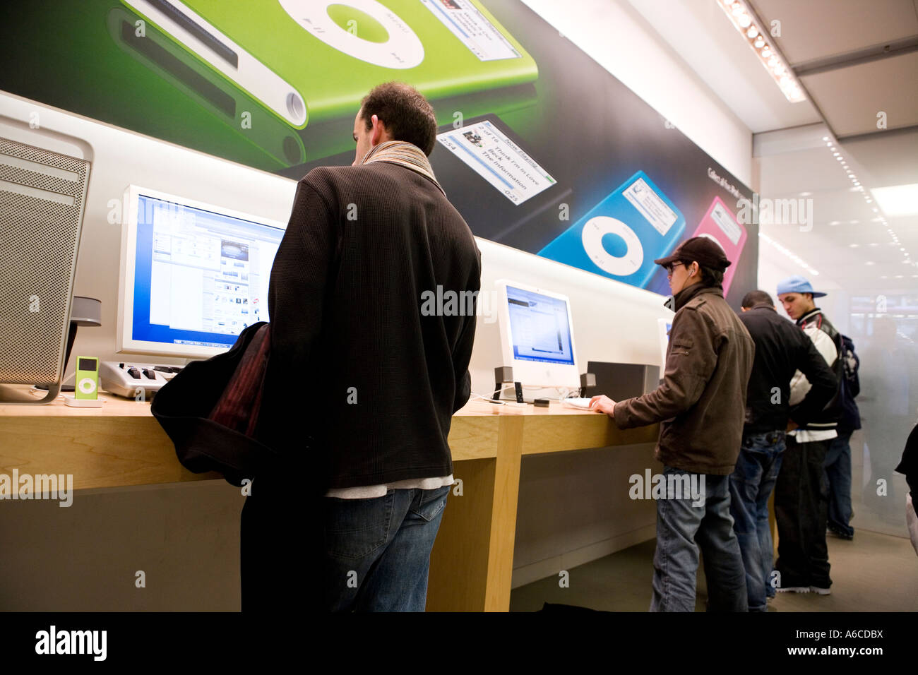 Apple store Regents Street Prospective buyers try out latest gadgets - Stock Image