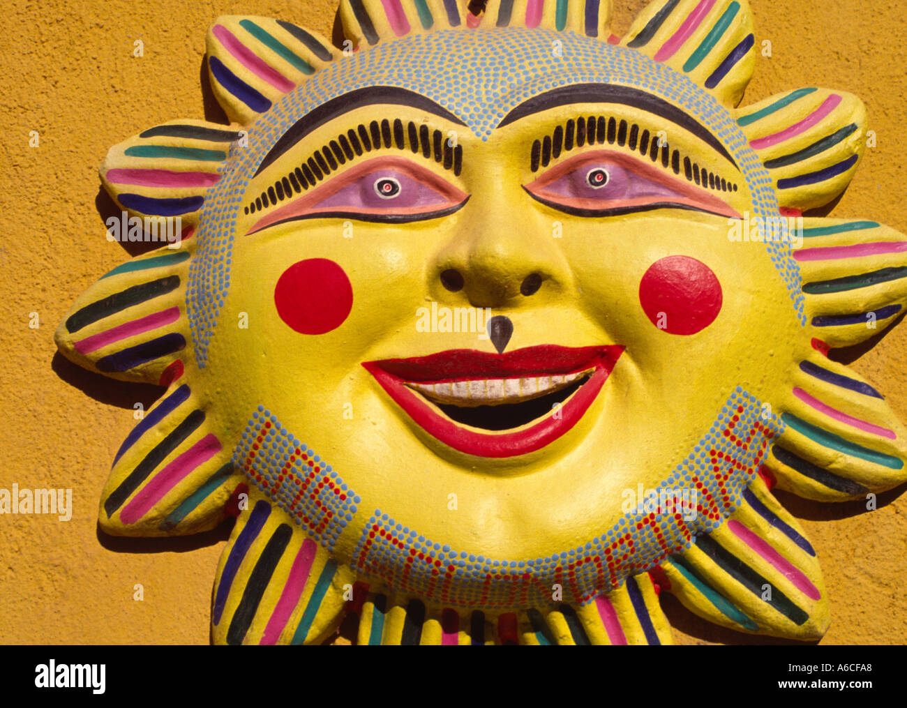 Smiling ceramic sun face mounted on a wall in Oaxaca Mexico Stock ...