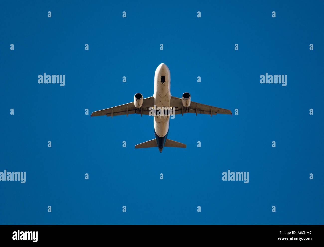 Passenger jet in blue sky - Stock Image