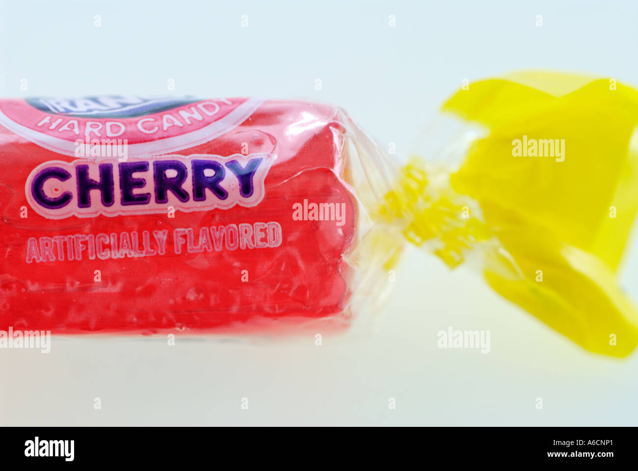 Hard wrapped candy red cherry flavour - Stock Image