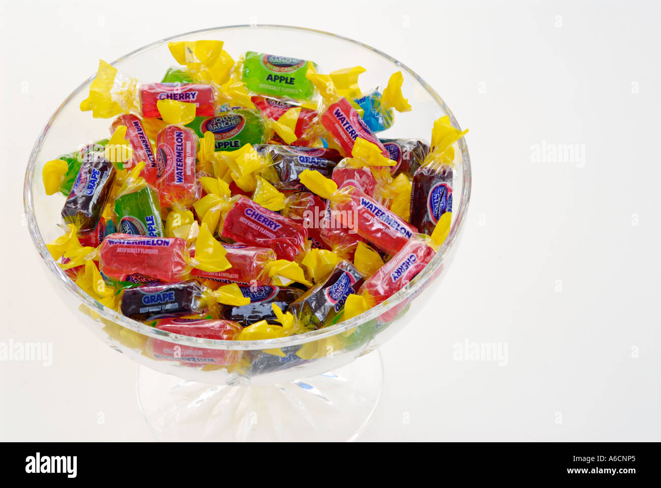 Hard wrapped candy in a crystal bowl - Stock Image