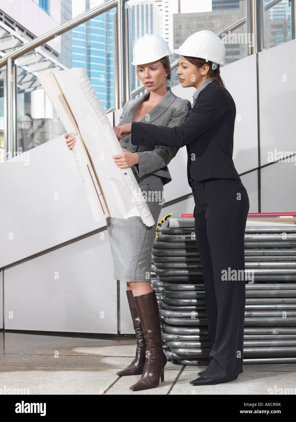 Businesswomen Looking at Plans Stock Photo