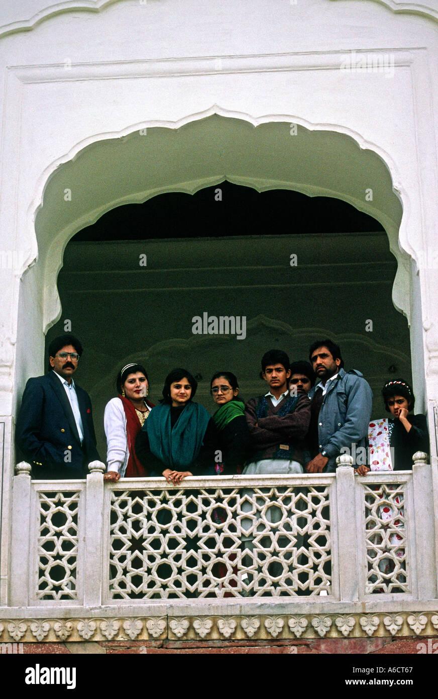 Pakistan Punjab Lahore Shalimar Gardens visitors on stone balcony - Stock Image
