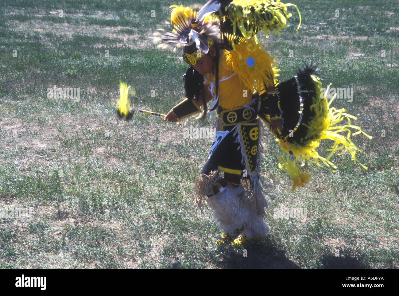 A young Sioux indian dances at a powwow at the Pine Ridge Indian Reservation - Stock Image