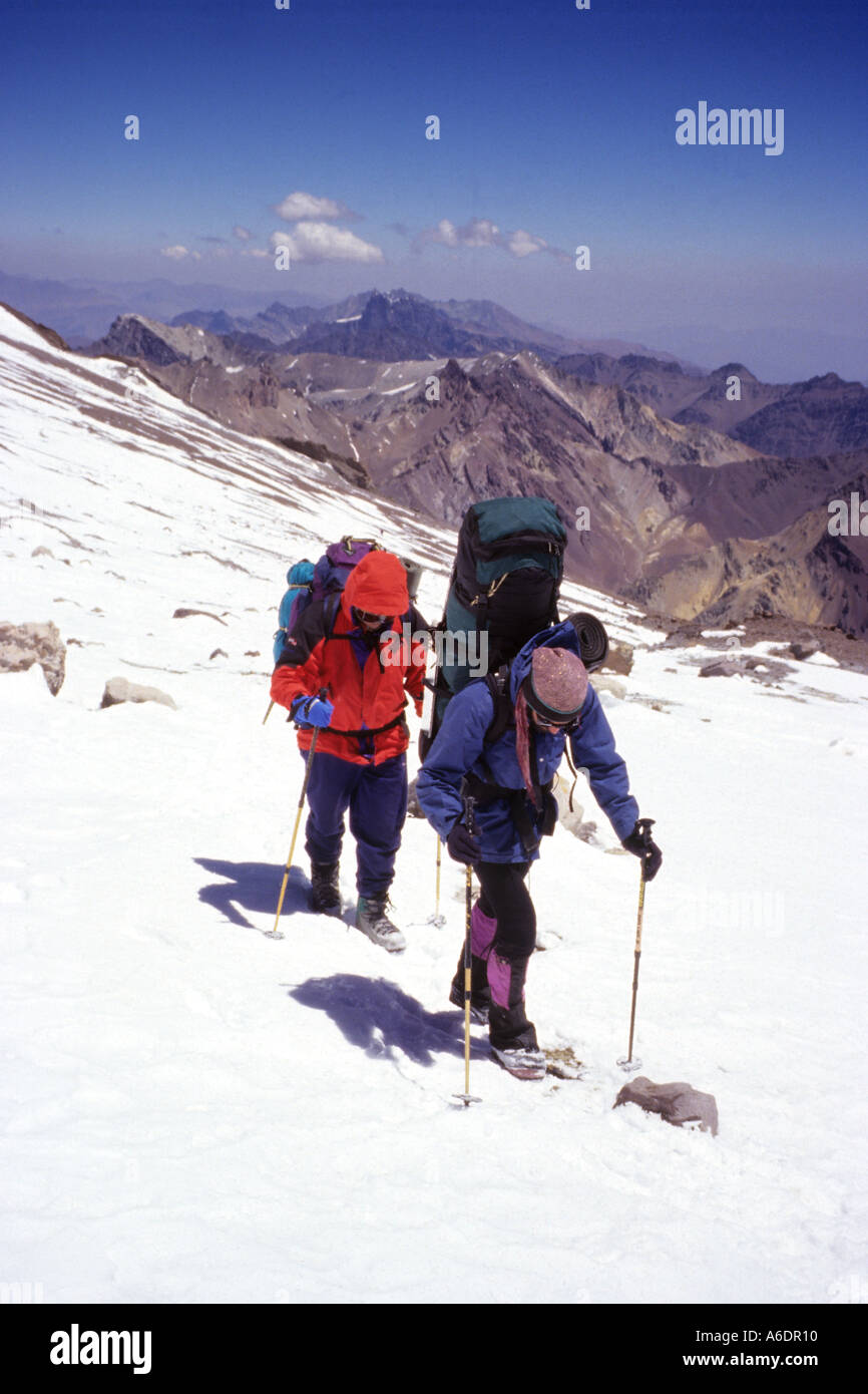 Mountaineers backpacking at altitude approaching Nido de Condores on Mount Aconcagua in Argentina Stock Photo