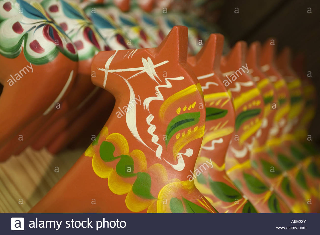 Rows of painted dalarna horses - Stock Image