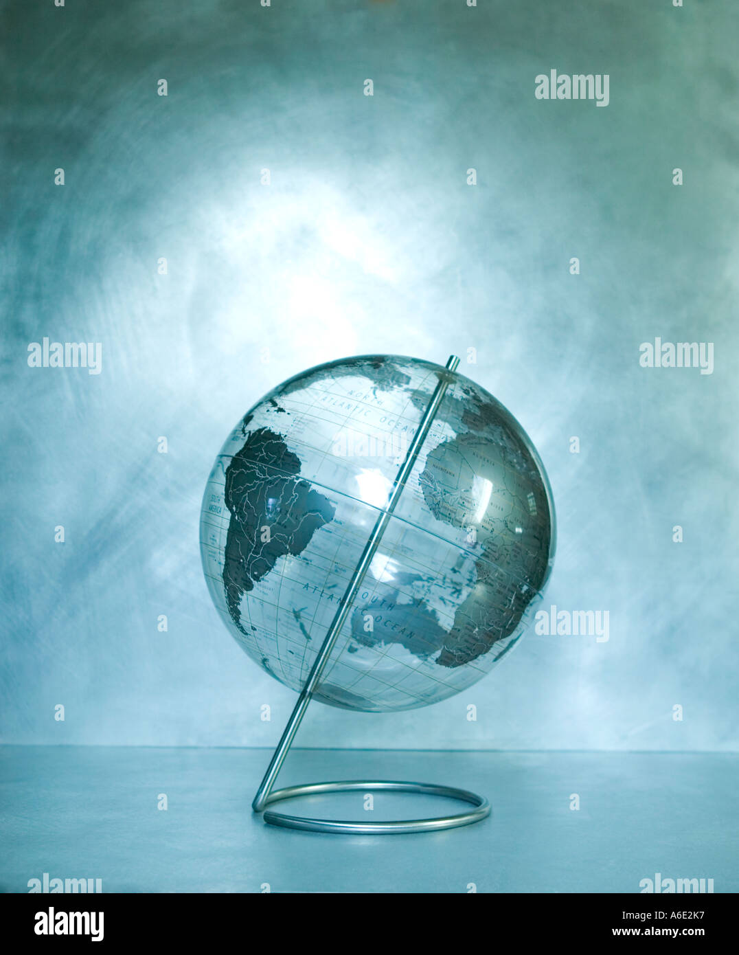 Clear Plastic World Globe on brushed Steel Background Stock Photo