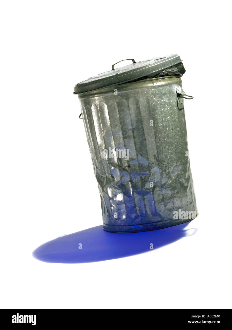 Metal garbage bin with blue shadow on white background Stock Photo