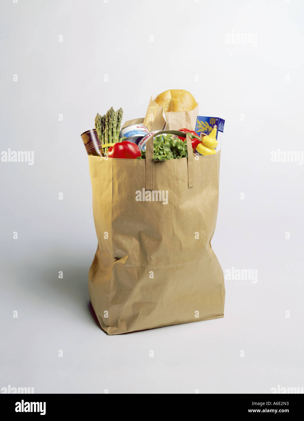 Bag of Groceries sitting on white background Stock Photo