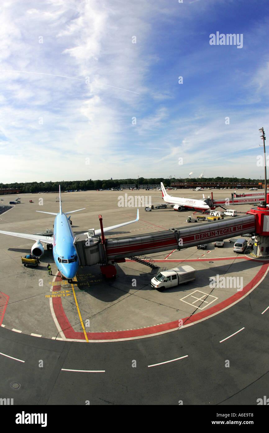 Airplane at boarding bridge at Tegel airport, Berlin - Stock Image