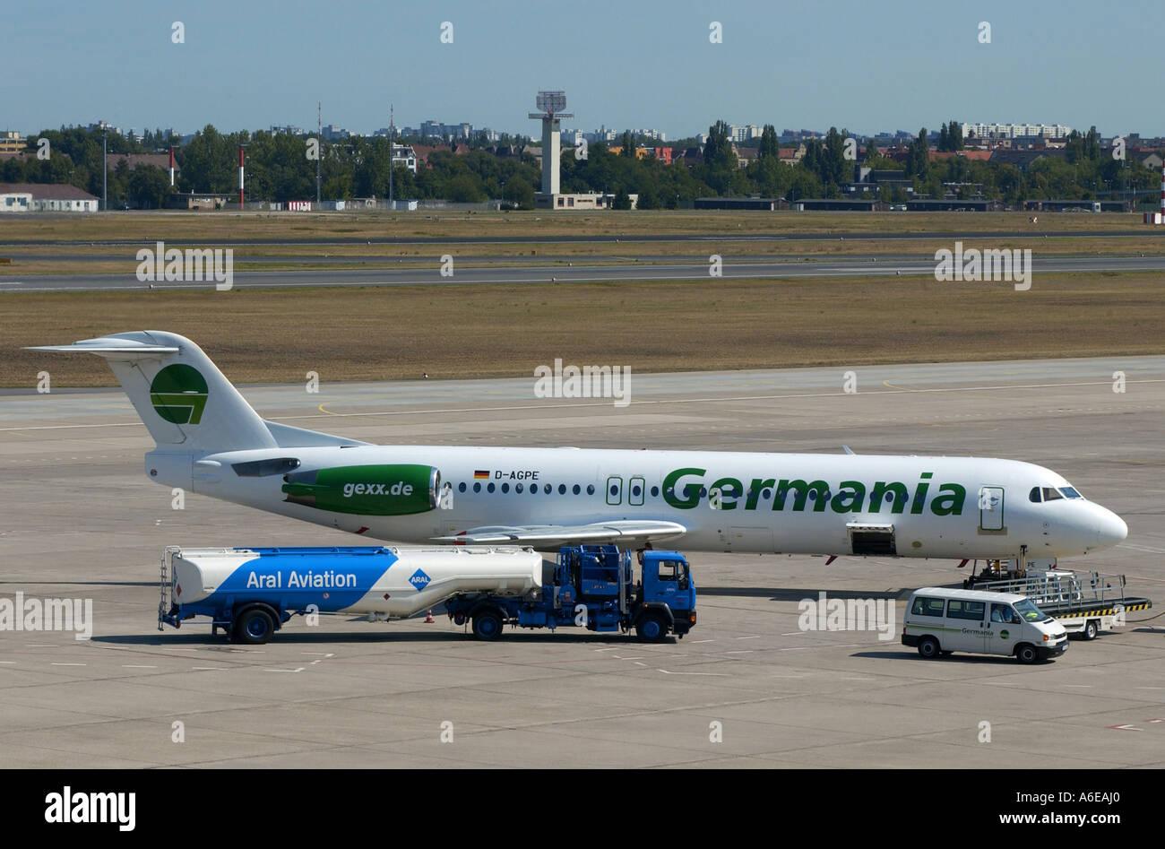 Air Germania airplane and ARAL kerasin tank truck at Tegel airport, Berlin - Stock Image