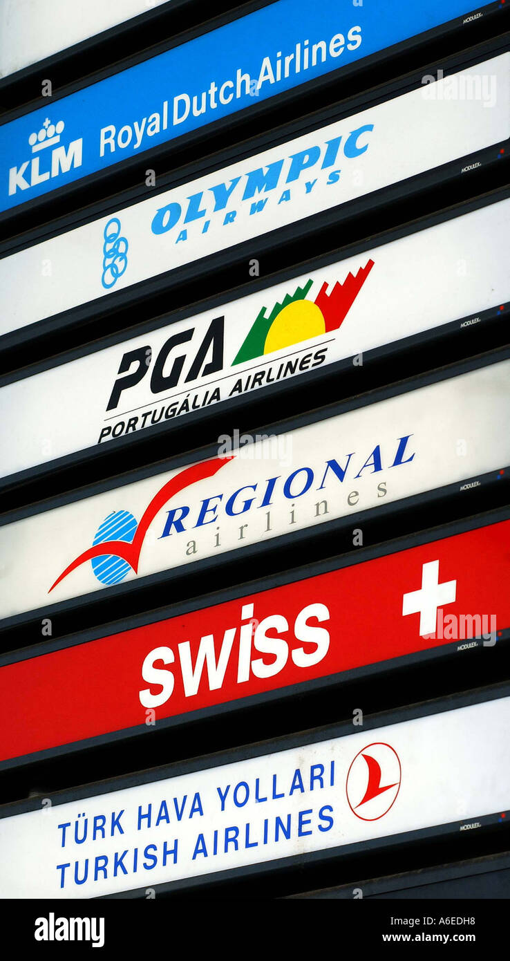 Light signs of different airlines: KLM, Olympic, PGA, Regional, swiss and Turkish, Germany - Stock Image
