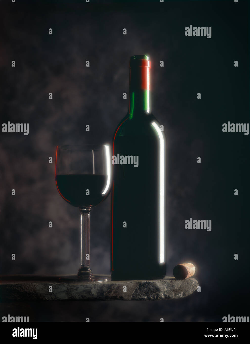 Still life photograph of Red Wine Bottle and Glass - Stock Image