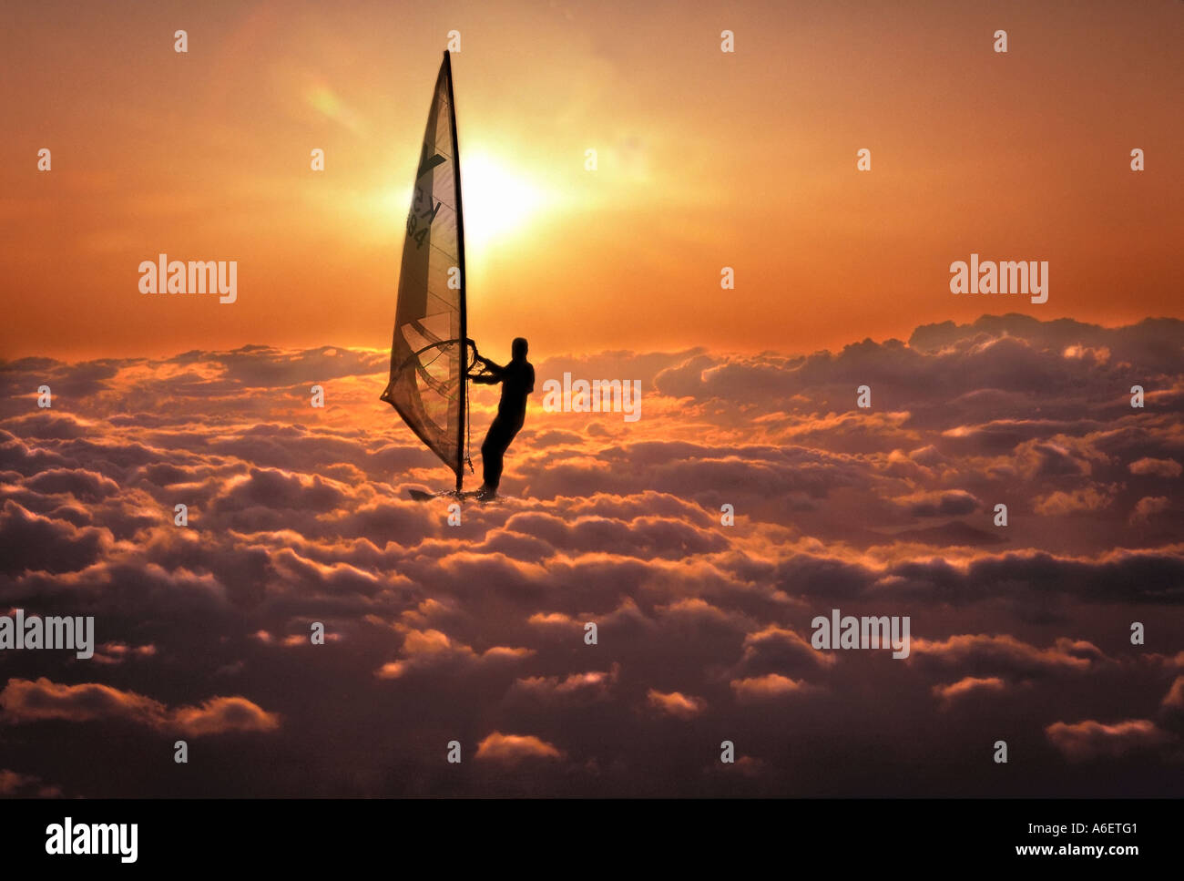Digital Composite Of Windsurfer Surfing The Clouds At Sunset