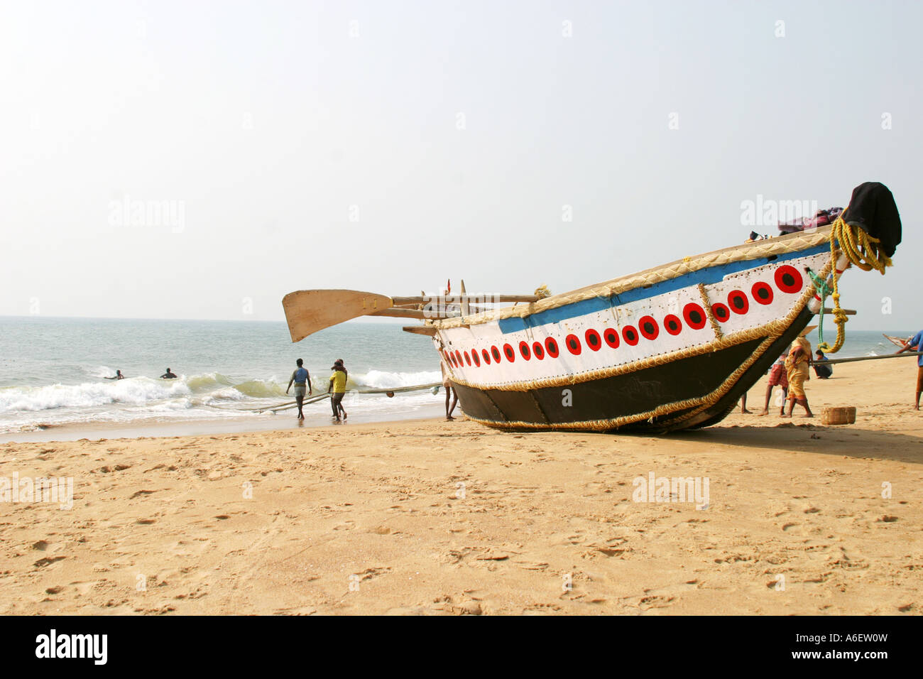 Fishing boat on the sands at Puri ,Bay of Bengal Orissa India               Fishing boat on the beach at Puri ,B Stock Photo