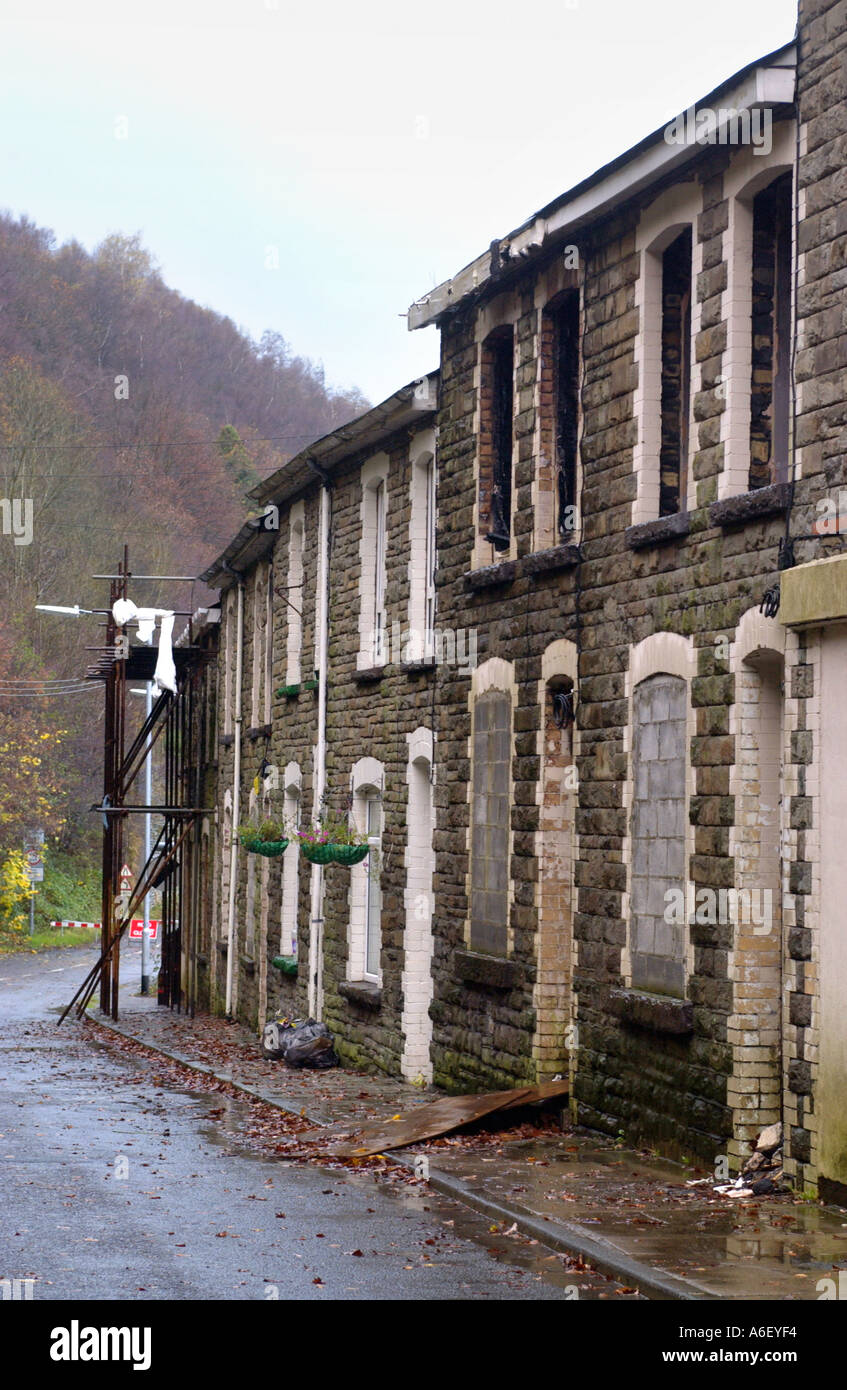 Terrace of burnt out derelict houses at Llanhilleth Blaenau Gwent South Wales UK - Stock Image