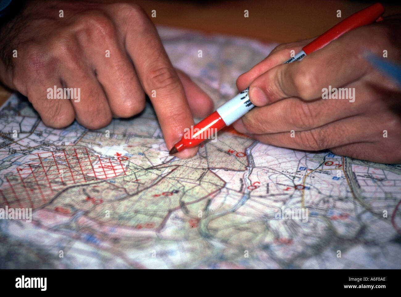 Fingers marking route on map - Stock Image