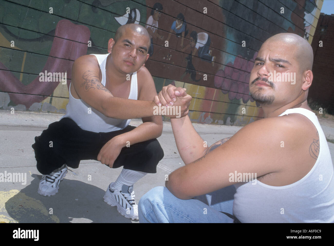 Former Latino gang members greeting each other in a park Los Angeles, United States of America - Stock Image