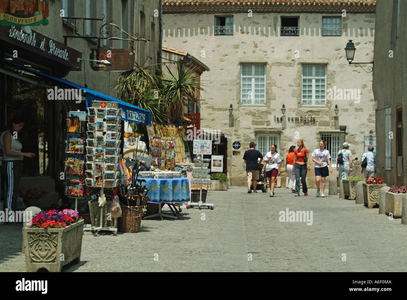 Carcassonne fortified medieval town typical street with shops and tourists Stock Photo