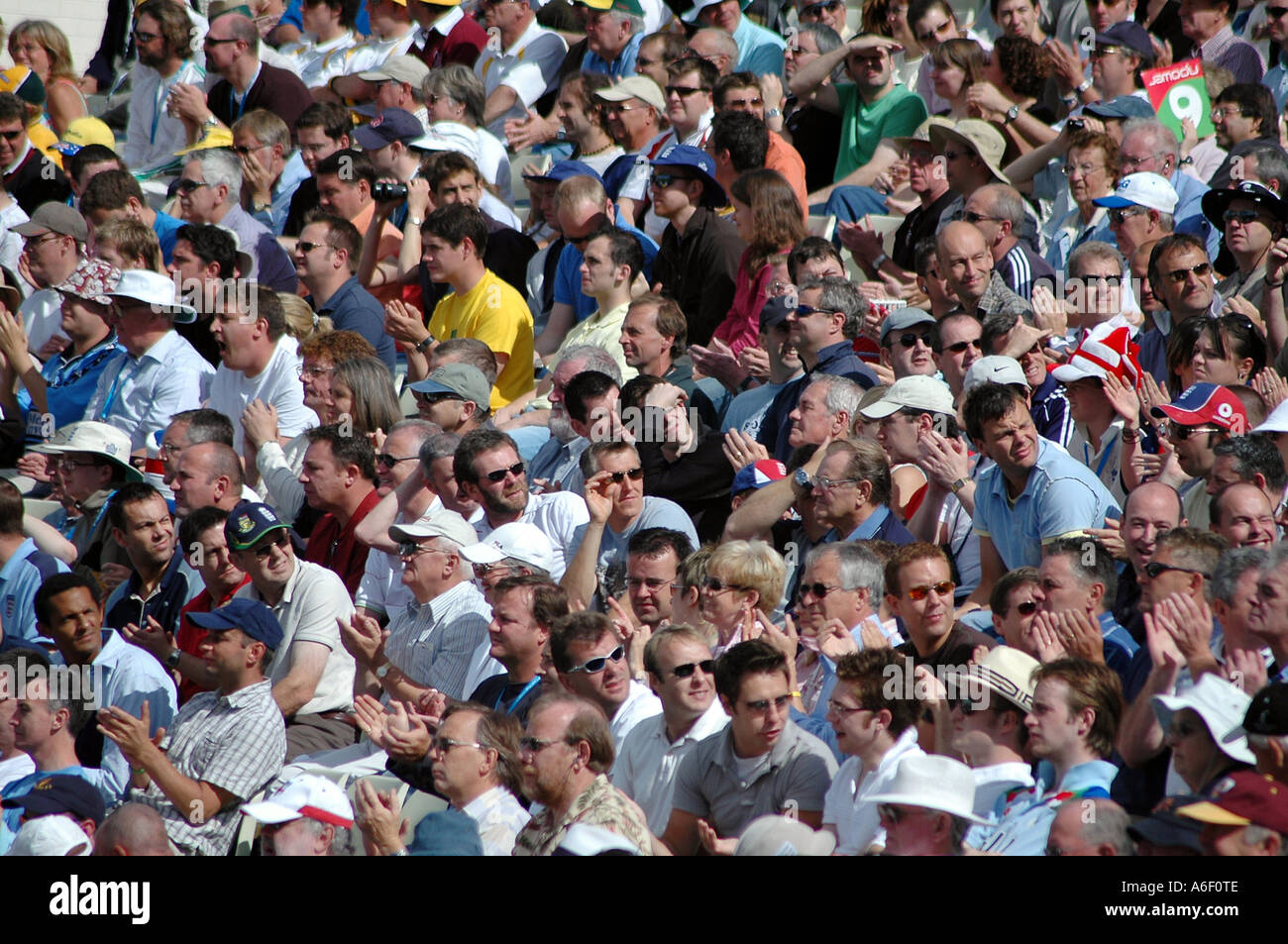 Crowd of spectators at a cricket match - Stock Image
