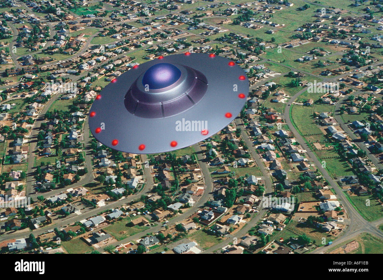 UFO over the suburbs - Stock Image