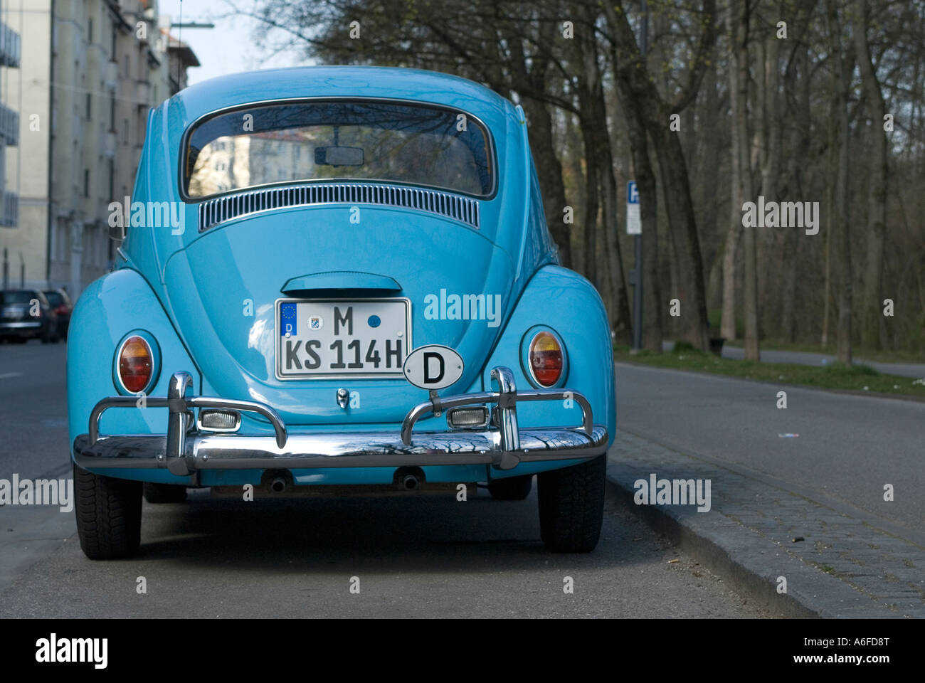 2367b19ee3 VW Beetle in light blue parked at the street side Germany - Stock Image
