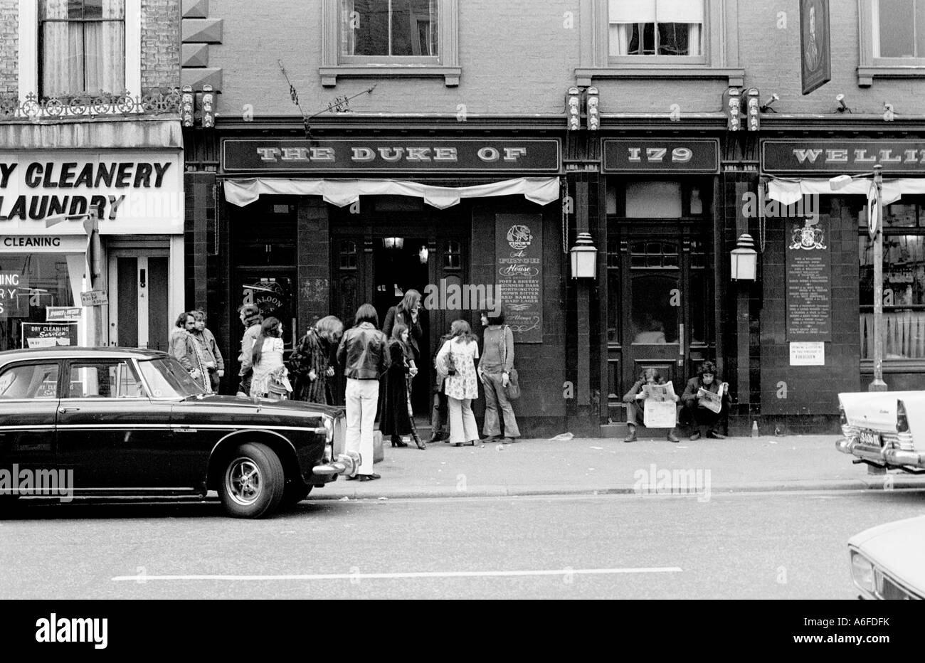 Hippies outside pub in Notting Hill Gate 1975. - Stock Image