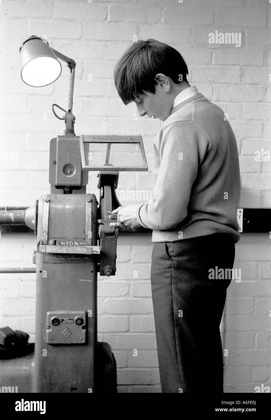 Boy pupil learning metalwork at school. London 1966. - Stock Image