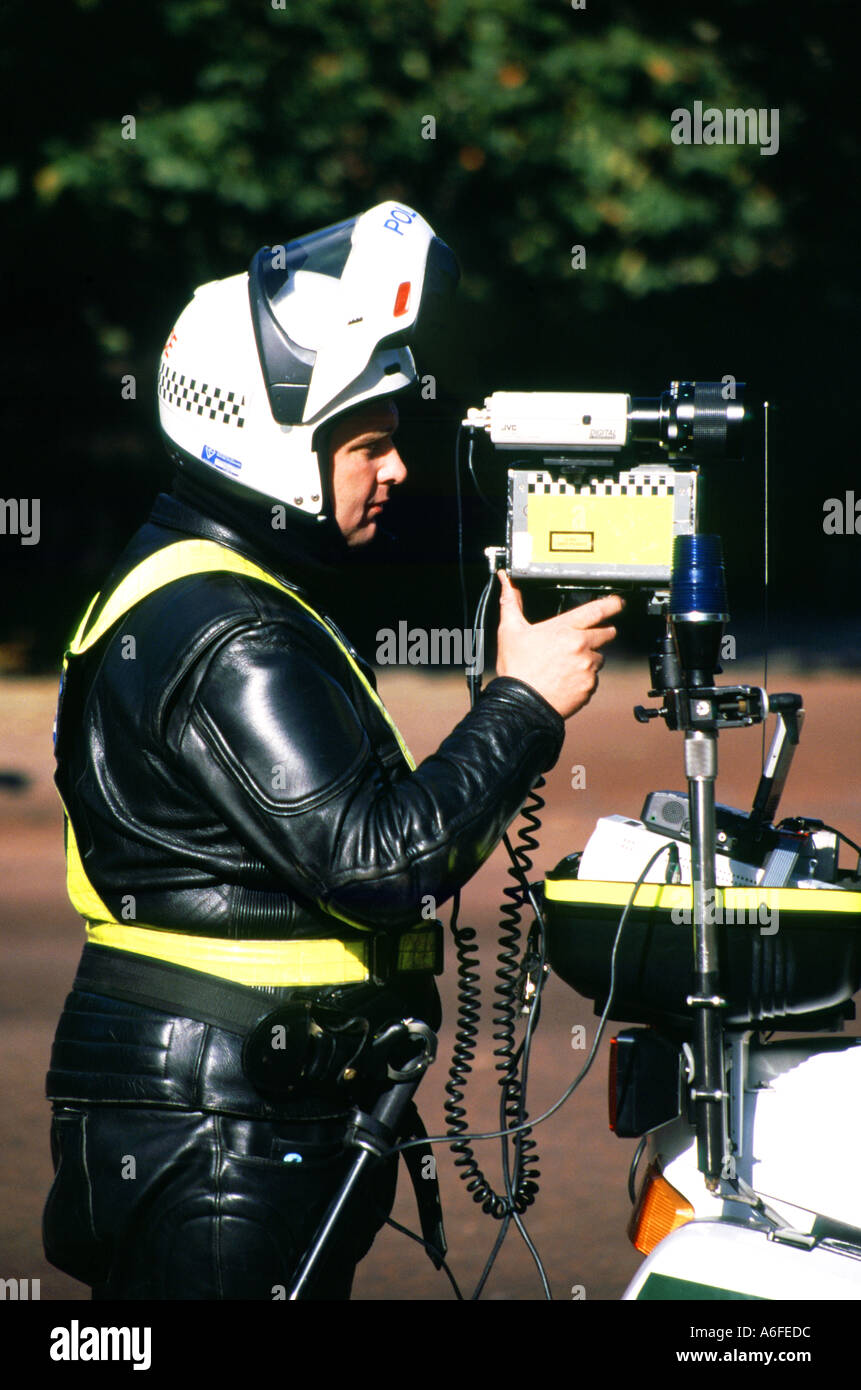 The Mall London Royal Parks police officer operating a speed check camera from rear of motorbike England UK Stock Photo