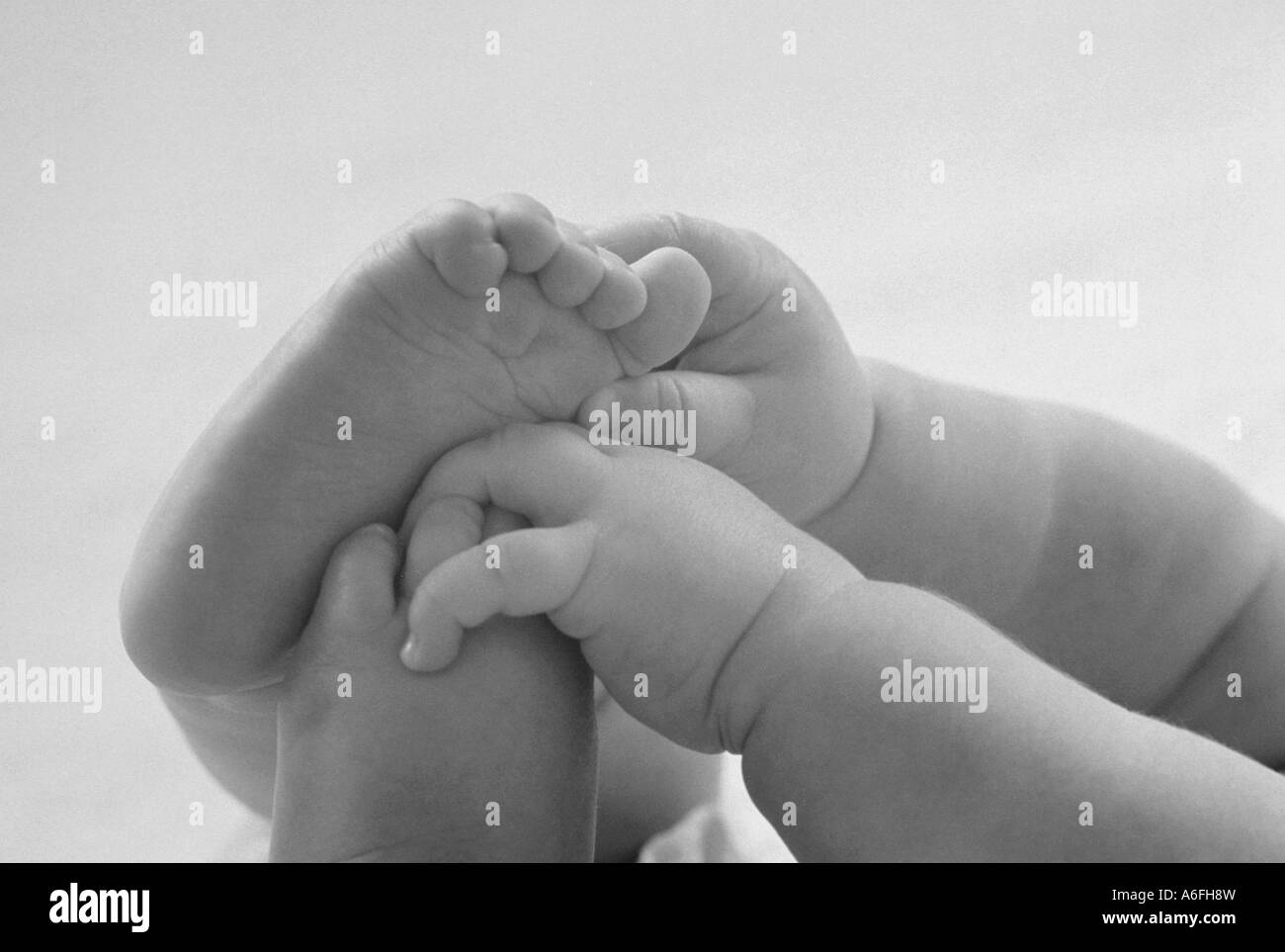 Baby hands and feet Stock Photo
