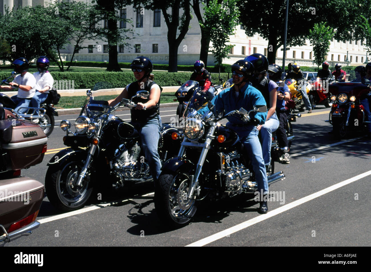 Harley Davidson riders motorcycles riding of the carnival parade in