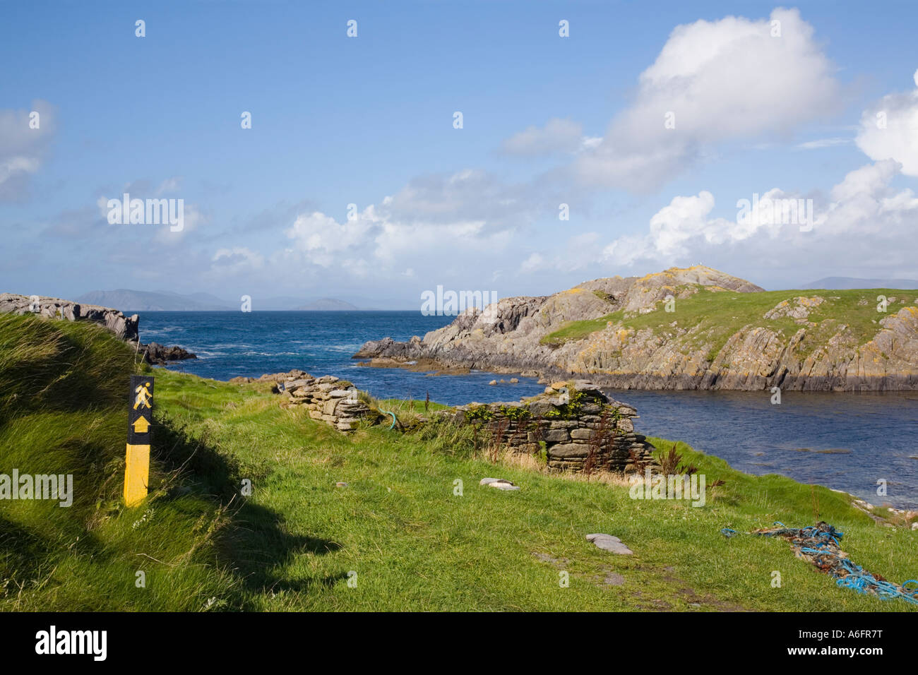 Beara Way long distance walk sign by small harbour on Ring of Beara tourist route on Beara Peninsula Garnish Point - Stock Image