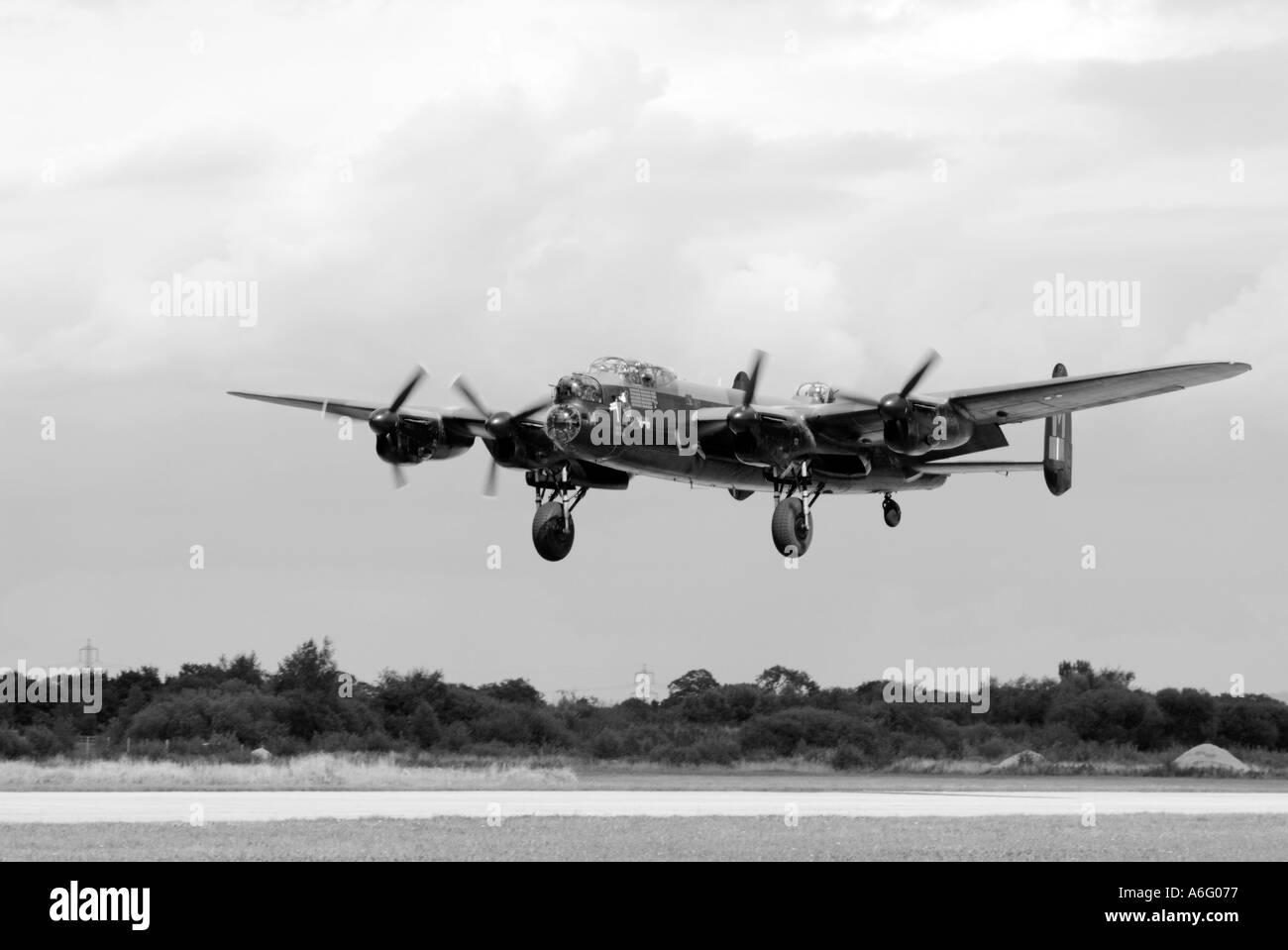 lancaster bomber RAF royal air force world war two 2 bomb rolls royce aero engine air crew solder fight germany destroy landing - Stock Image