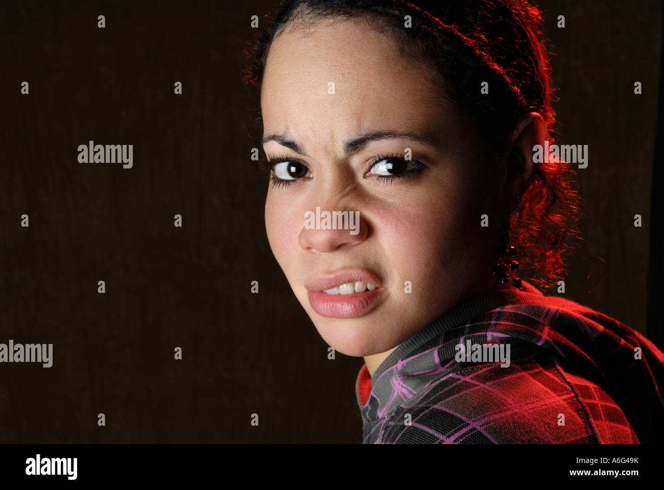 Portrait, Woman snarling - Stock Image