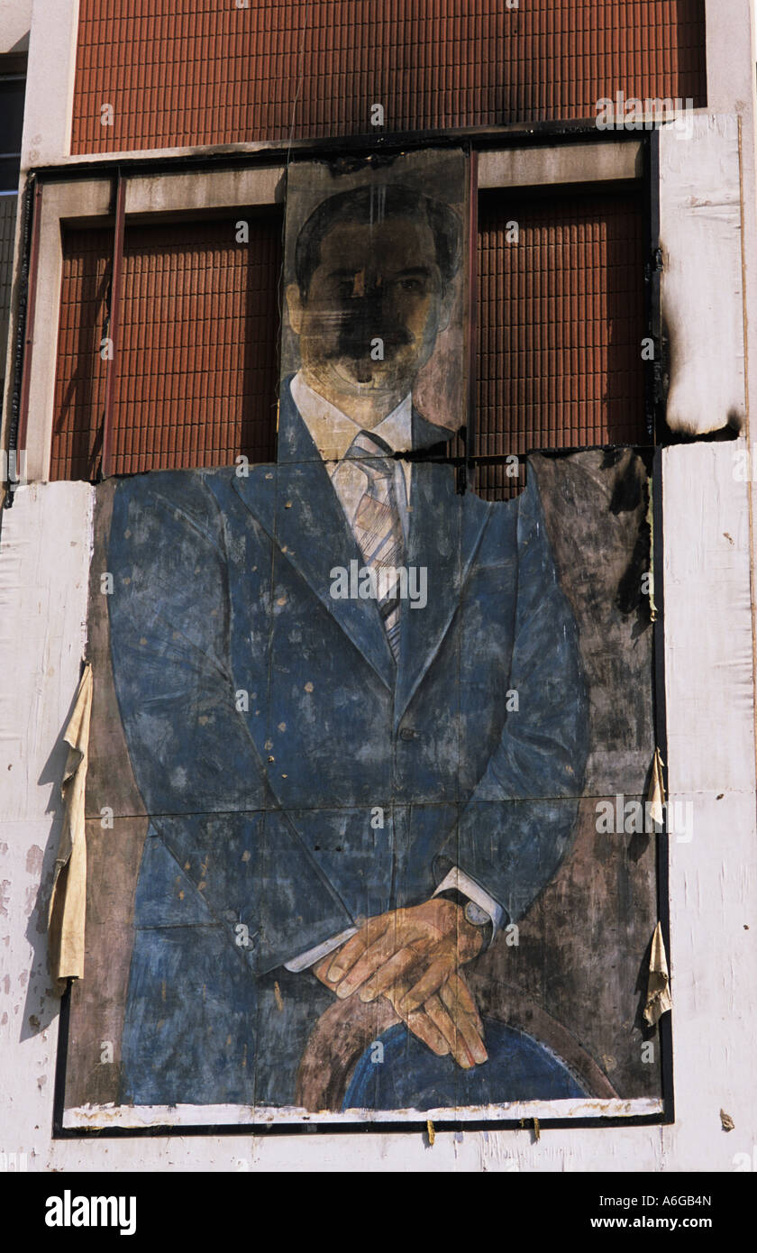 Baghdad Iraq 2003 Defaced portrait of Saddam Hussein - Stock Image