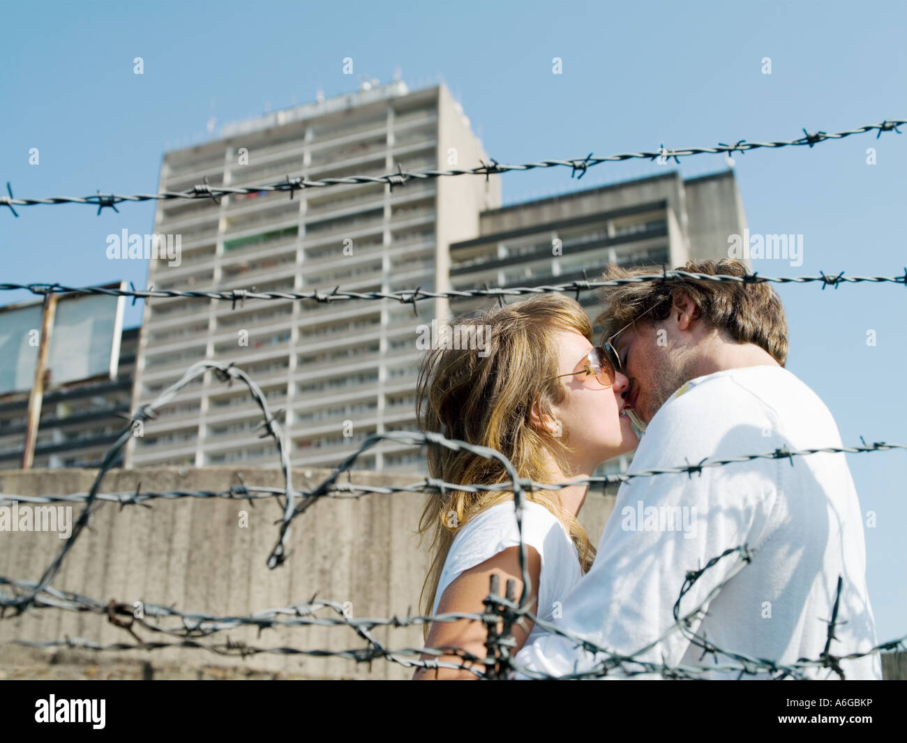 Young couple kissing in urban setting Stock Photo
