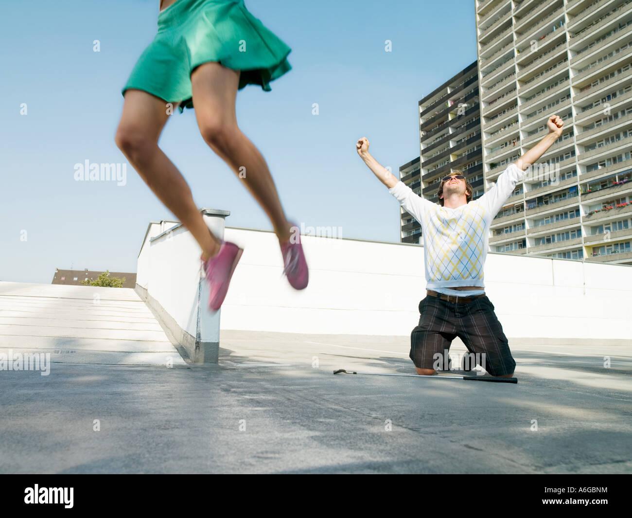 Joyful urban golfers - Stock Image