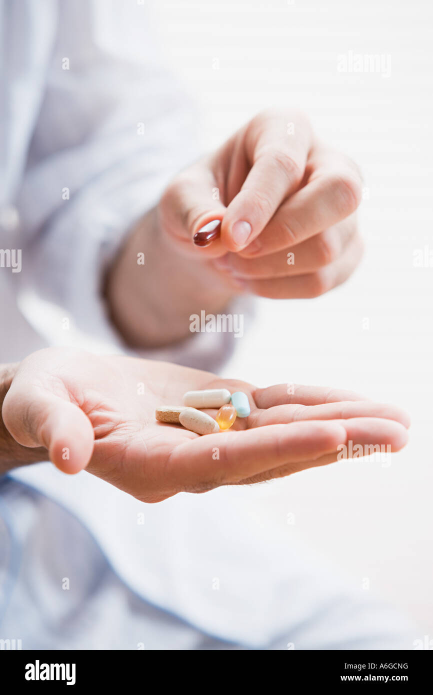 Man holding tablets - Stock Image