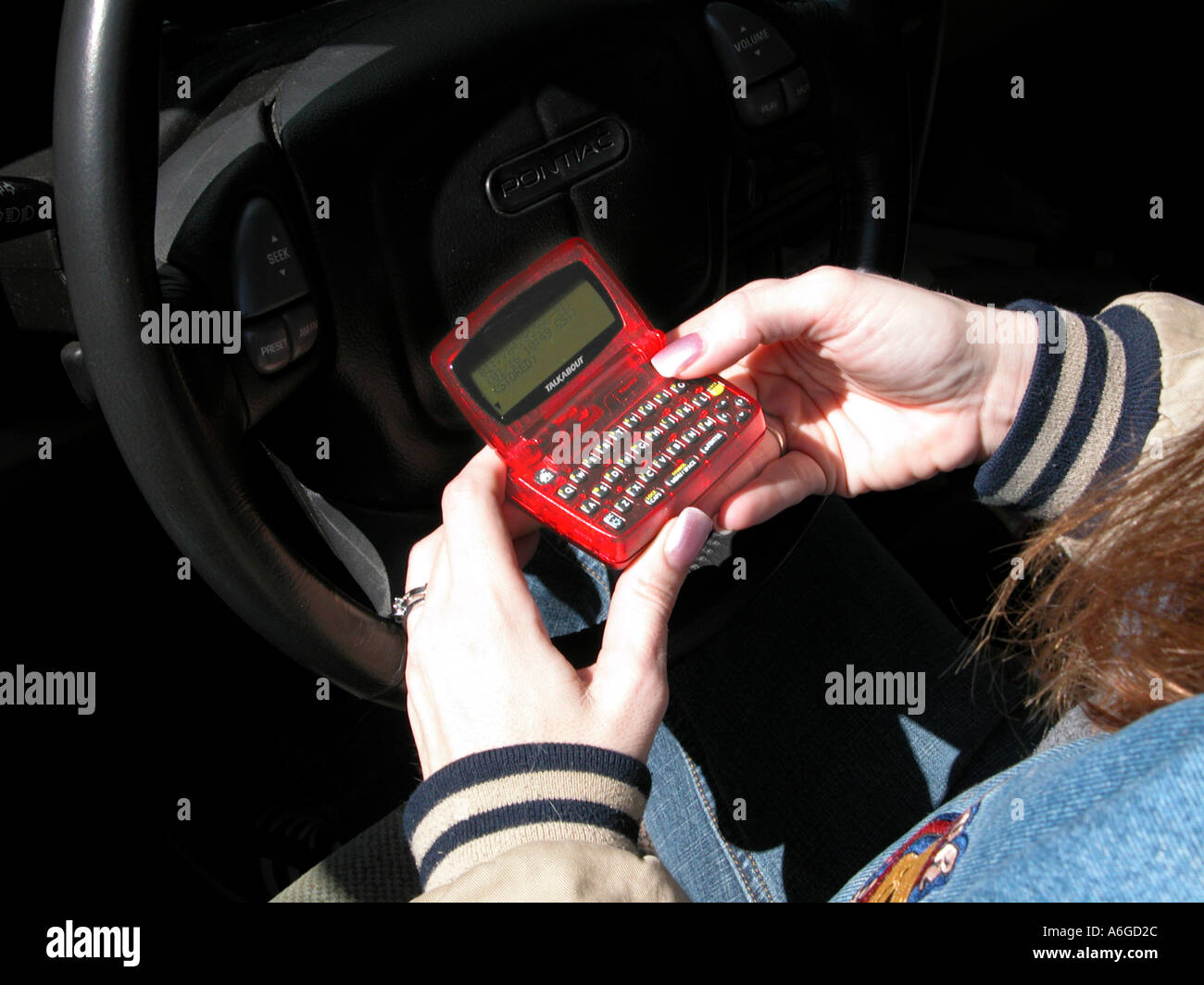 Woman reading hand help pager  Stock Photo