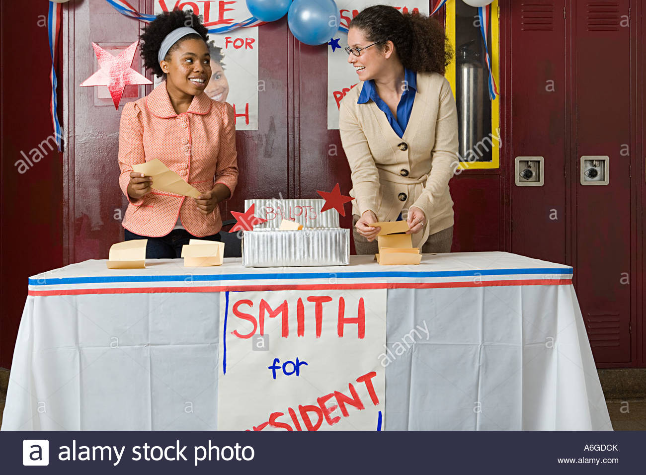 Girl and teacher counting votes - Stock Image