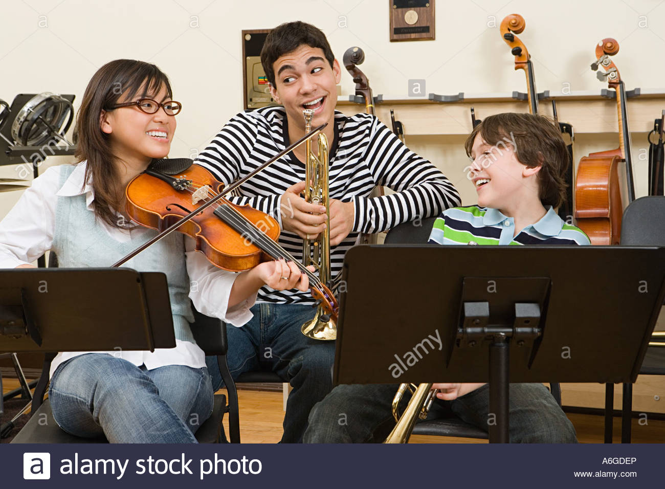Friends at band practice - Stock Image