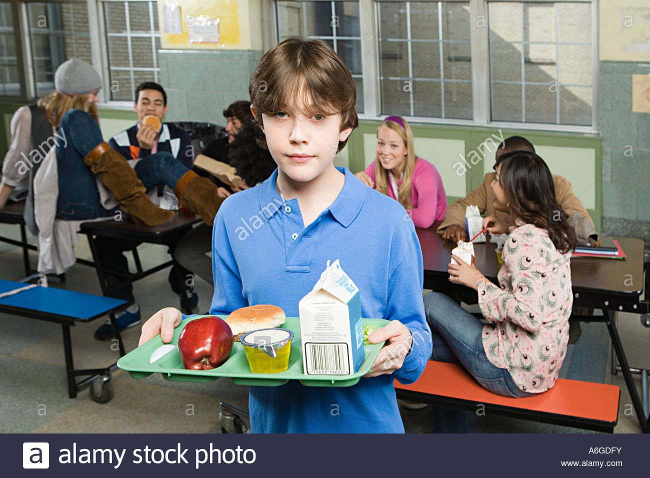 Boy in cafeteria - Stock Image
