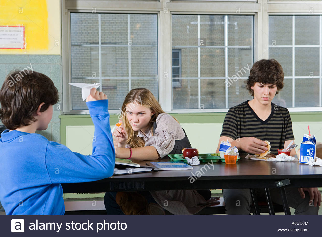 Teenagers in cafeteria - Stock Image