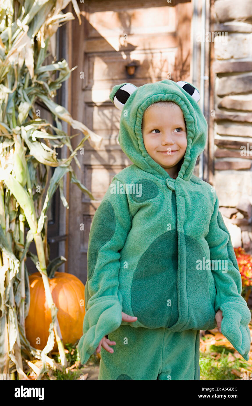 Boy dressed as a frog - Stock Image