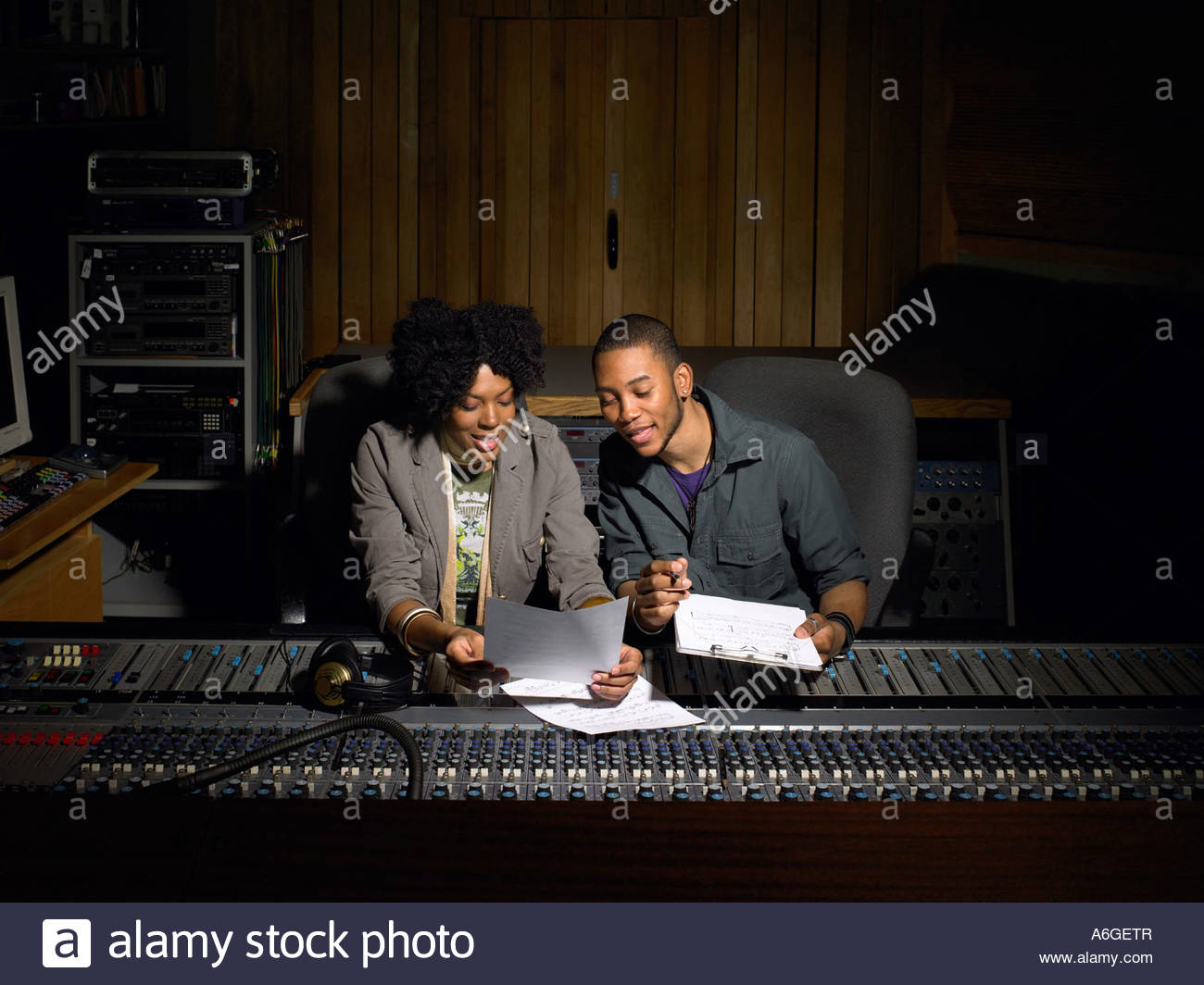 Two music producers working - Stock Image