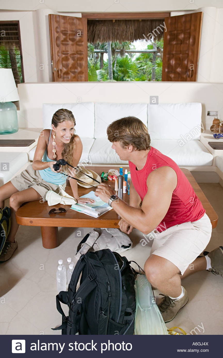 Couple preparing for trip - Stock Image
