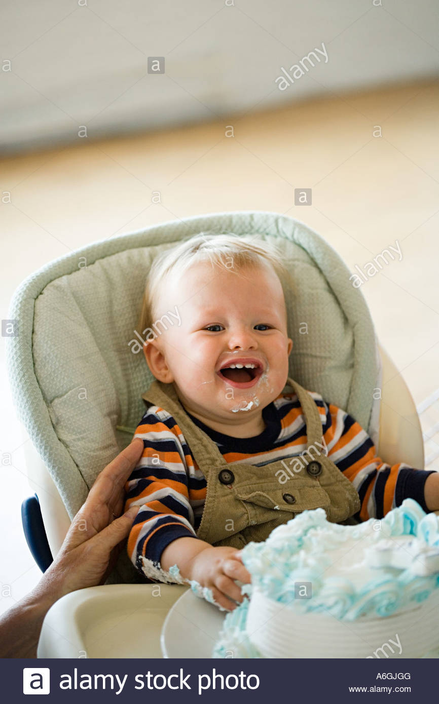 One year old with birthday cake - Stock Image