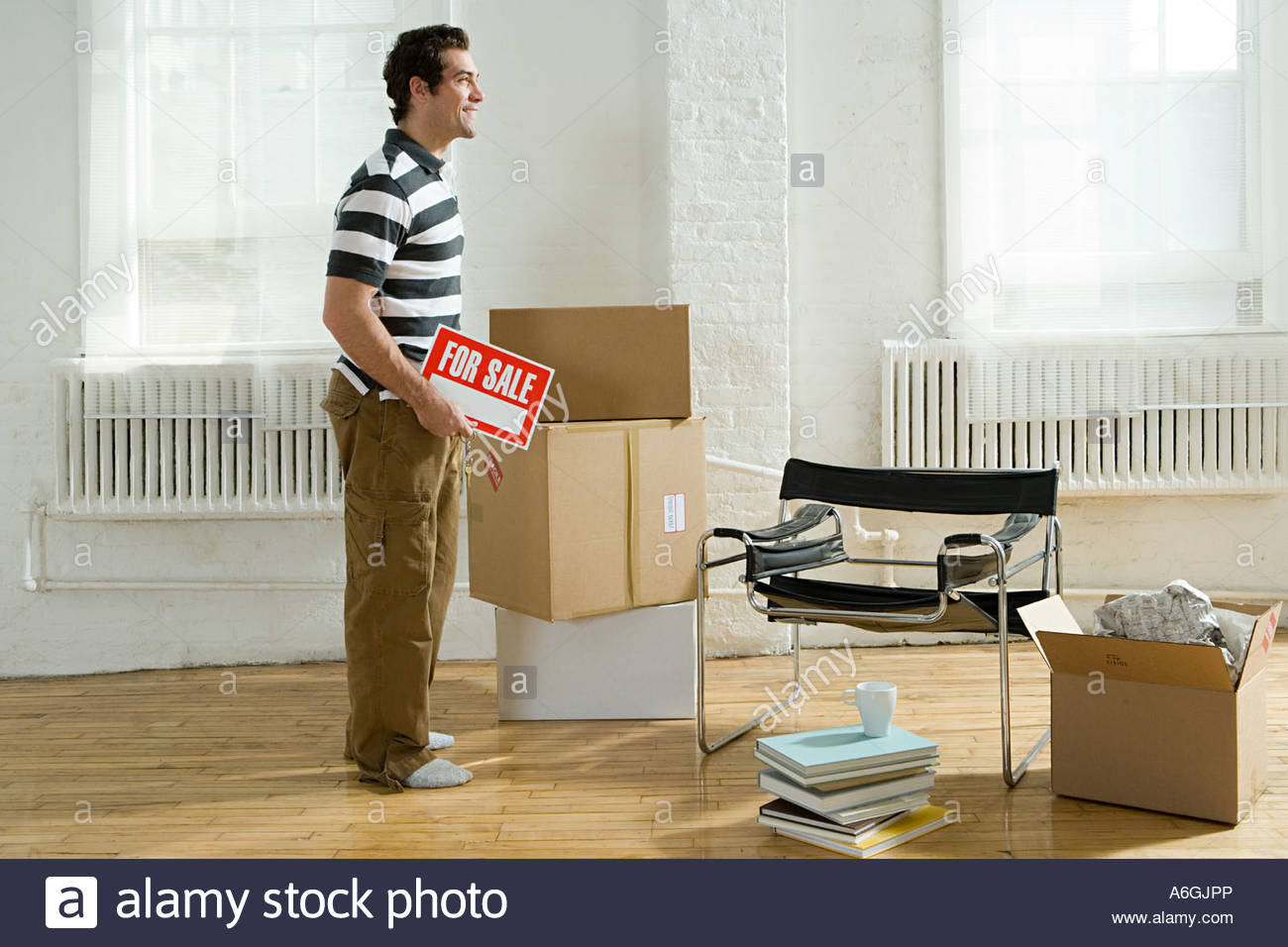 Man moving house - Stock Image